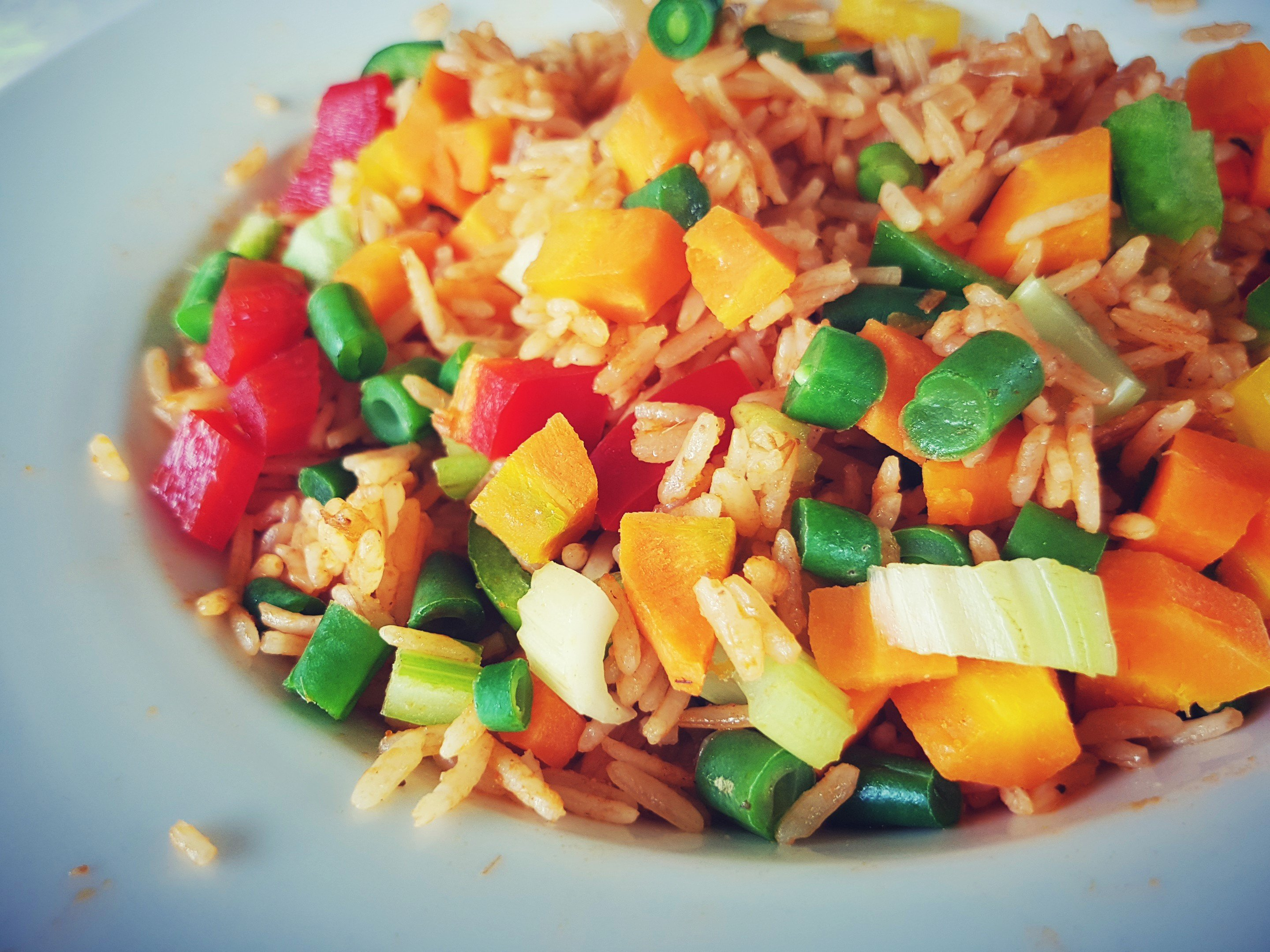 5. when the rice is cooling, chop the veggies finely and keep aside.  remember to chop the french beans very finely. they take more time to cook  than other ...